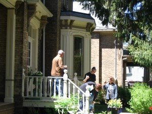 Guests exit a home on Peel Street during the Welcome Home Tour.