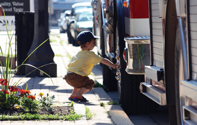 1-year-old Keagan Ceccato investigates a Wilmot Fire Department truck during the annual Firefighter Breakfast held at the New Hamburg Fire Hall on June 10.